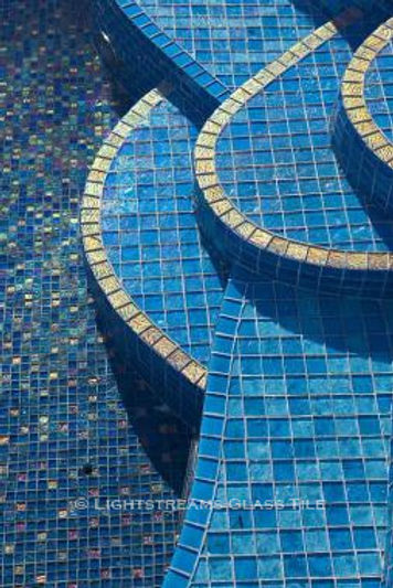 American Made Lightstreams Glass Tile Turquoise is used as pool tile and spa tile for this all tile pool and all tile spa. Lightstreams Jewel accent tiles are used as step marker tile and accents the waterline