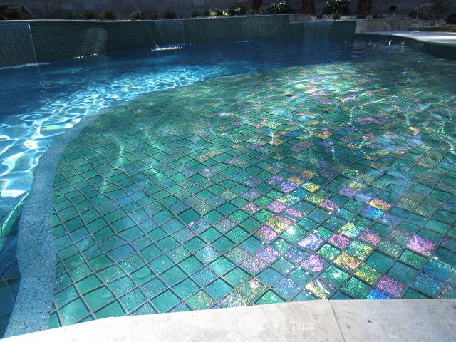 American Made Lightstreams Glass Tile Renaissance Collection Celadon green tile is used as pool tile, spa tile, waterline tile, wall tile, fountain tile, and step marker tile for this pool and spa showing the iridescent tile of Lightstreams signature reversible tile