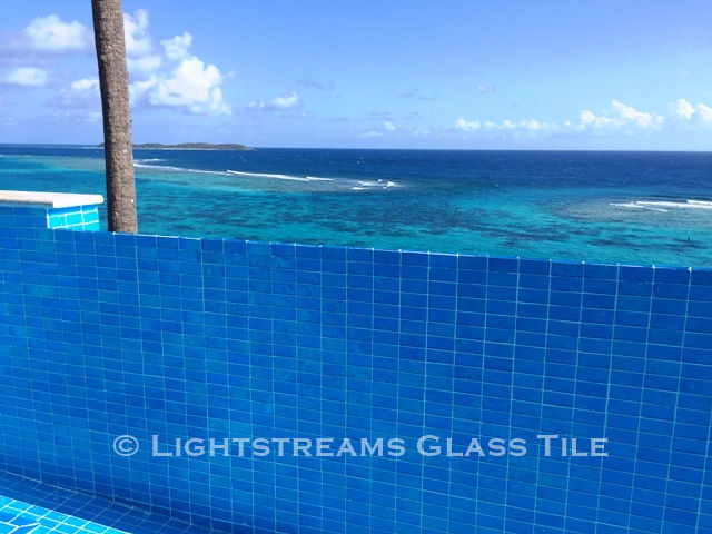 American Made Lightstreams Glass Tile Aqua Blue tile is used as pool tile wall tile, and spa tile for this all glass tile pool.