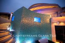 American made Lightstreams Glass Tile is used for pool tile, spa tile, waterline tile, step marker tile, accent tile, wall tile, fountain tile, floor tile, bathroom tile, shower tile, kitchen tile, and kitchen backsplash tile. The glass pool tile used for this swimming pool is Lightstreams Gold Iridescent Collection Aquamarine in 2x2 tile size.