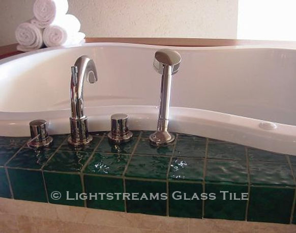 American Made Lightstreams Glass Tile Renaissance Collection Jade green tile is used around this bathroom tub. It can also be used as pool tile, spa tile, bathroom tile, shower tile, wall tile, floor tile, waterline tile, backsplash tile, step marker tile, and kitchen tile