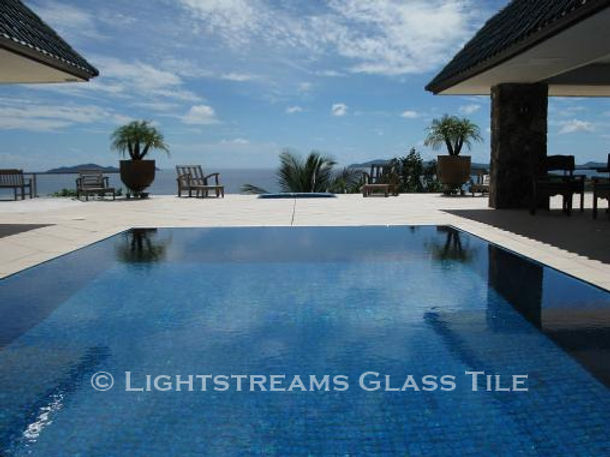 American Made Lightstreams Glass Tile Turquoise is used as pool tile for this all tile pool
