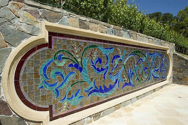 American Made Lightstreams Glass Tile Secret Garden Jewel glass accent tiles are just one of the patterns of Jewel Glass Accent tiles embellishing this beautiful custom hand-cut glass mural. This blue tile / green tile jewel glass accent tile can also be used as shower tile, bathroom tile, kitchen tile,  pool tile, spa tile, waterline tile, step marker tile, floor tile, wall tile, and fountain tile.