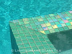 American made Lightstreams Glass Tile Renaissance Collection Celadon green as pool tile, waterline tile, and spa tile with iridescent tile step markers