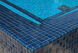 American made Lightstreams Glass Tile all glass tile pool Gold Iridescent Steel Blue tile and Renaissance Collection Aqua Blue tile as pool tile, spa tile and accent tile step marker tile