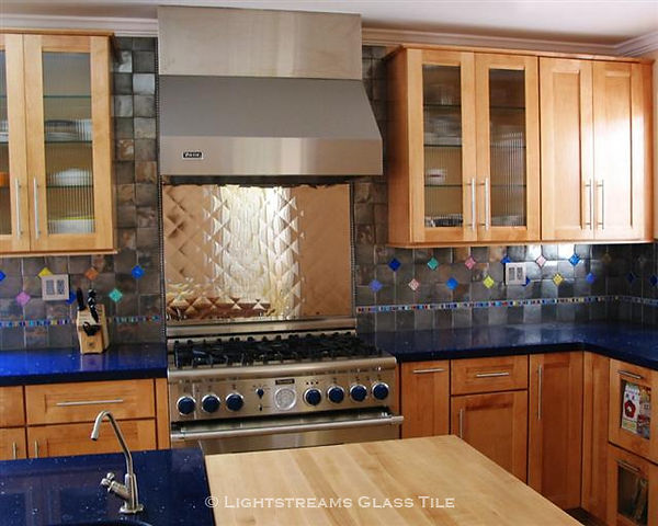 American Made Lightstreams Glass Tile Pink Perfection Jewel Glass accent tile is just one of the patterns used in this whimsical stainless steel kitchen backsplash.  Jewel Inlays glass accent tile strands also highlight the kitchen backsplash.