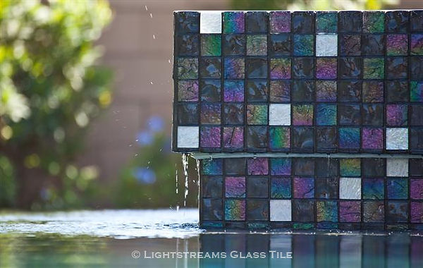 American made Lightstrems Glass Tile spa is tiled with Lightstreams Renaissance Collection Dark Silver iridescent glass tile, and dramatically accented with Lightstreams High Noon Jewel white tile glass accent tiles: also can be used as accent tile for shower tile, backsplash tile, kitchen tile, bathroom tile, floor tile, pool tile, waterline tile, step marker tile, spillway tile, and wall tile