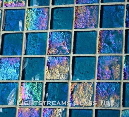 High quality American Made Lightstreams Glass Tile Renaissance Collection II Turquoise 3.0 blue glass tiles are a deep, shiny blue on one side, with subtle rainbow iridescent colors on the reverse textured side. This blue tile can also be used for pool tile, spa tile, fountain tile, fire pit tile, wall tile, waterline tile, step marker tile, exterior tile, interior tile, accent tile, iridescent tile, backsplash tile, kitchen tile, bathroom tile, floor tile, and shower tile