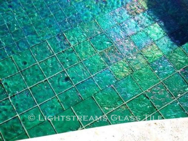 American Made Lightstreams Glass Tile Renaissance Collection Jade green tile is used for this all tile pool and spa . It can also be used as pool tile, spa tile, bathroom tile, shower tile, wall tile, floor tile, waterline tile, backsplash tile, step marker tile, and kitchen tile. Iridescent tile side showing only.