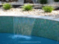American Made Lightstreams Glass Tile Renaissance Collection Celadon green tile is used as pool tile, spa tile, waterline tile, wall tile, fountain tile, and step marker tile for this pool, spa, waterline, wall, and fountain