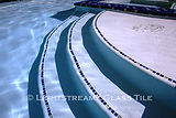 American made Lightstreams Glass Tile Renaissance Collection Peacock Blue pool tile on the waterline and for glass pool tile step markers