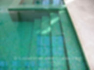 This all tile pool is tiled with Lightstreams Glass Tile Renaissance Collection Celadon green tile as pool tile, spa tile, waterline tile, and step tile.