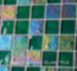 High quality American Made Lightstreams Glass Tile Renaissance Collection II Jade 2.0 glass tiles are a rich emerald green color.  There are beautiful rainbow iridescent colors on the reverse textured side of the tile. This green tile can also be used for pool tile, spa tile, fountain tile, fire pit tile, wall tile, waterline tile, step marker tile, exterior tile, interior tile, accent tile, iridescent tile, backsplash tile, kitchen tile, bathroom tile, floor tile, and shower tile