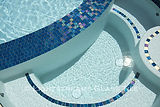 American made Lightstreams Glass Tile Renaissance Collection Peacock Blue pool tile on the pool waterline and spa waterline and steps as step marker tiles qith 24k gold accent tile
