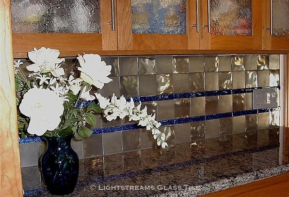 """stainless steel kitchen backsplash tile is accented with Lightstreams Glass Tile Galaxy Blue Jewel glass accent tile 1""""x6"""" liner bars:American made Blue Tile Jewels which can be used as accent tile for pool tile, spa tile, waterline tile, floor tile, wall tile, step glass tile, step marker tile, fountain tile, kitchen tile, backsplash tile, shower tile, bathroom tile, and spillway tile"""