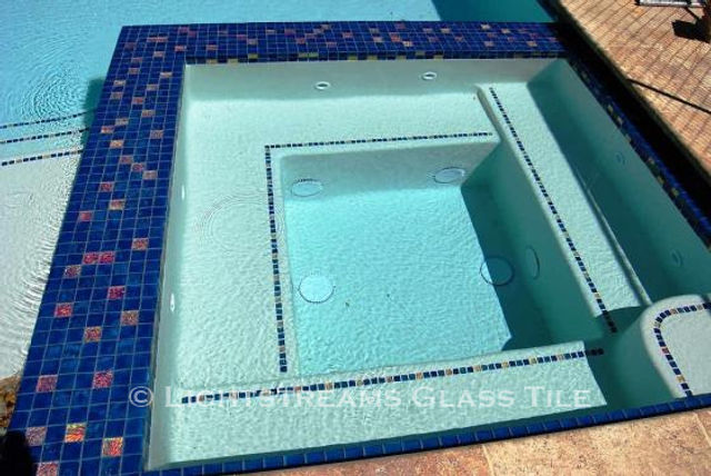 American Made Lightstreams Glass Tile Renaissance Collection Peacock Blue tile is used as step marker tile, pool tile, spa tile, and waterline tile and has accent tile made from Lightstreams Jewel Accent Tiles