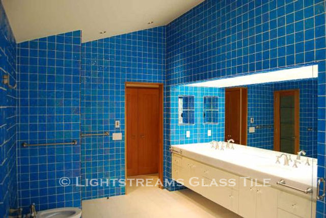 American Made Lightstreams Glass Tile Turquoise is used as bathroom tile, shower tile, and wall tile for this all tile bathroom. This bathroom only displays the shiny smooth side of Lightstreams iridescent / shiny reversible blue tile.