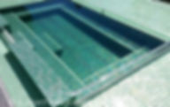 American Made Lightstreams Glass Tile Renaissance Collection Celadon green tile is used as pool tile and spa tile for this all tile pool and all tile spa showing the iridescent tile of Lightstreams signature reversible tile
