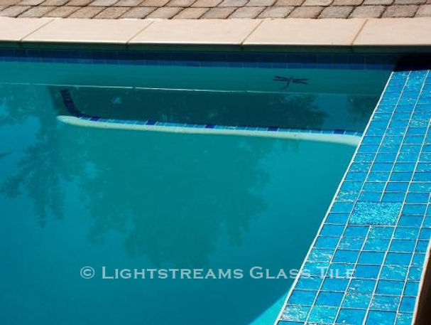 American Made Lightstreams Glass Tile Aqua Blue tile is used as pool tile, step marker tile, waterline tile, and spa tile mixed with Lightstreams accent tile Jewel Collection
