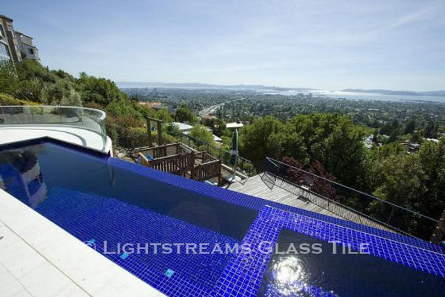 American Made Lightstreams Glass Tile Renaissance Collection Royal Blue tile for this all tile pool tile, spa tile, spillway tile, exterior tile using only the shiny side of the Lightstreams Royal Blue tile.