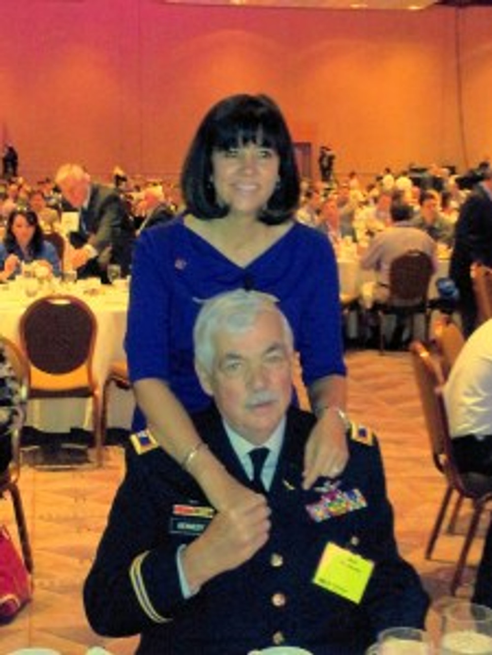 Mary Thompson, COO of Dwyer Group, and her father Marine Col. Jack Kennedy.