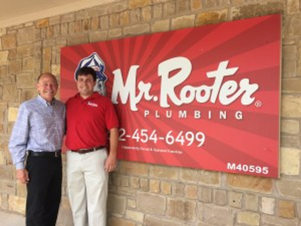 Mike Bidwell, CEO of Dwyer Group, and his son Brett Bidwell, franchisee of Mr. Rooter of Greater Austin.