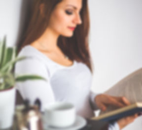young-woman-relaxing-at-home-and-reading