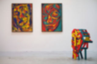 Picture taken of two acrylic paintings and a sculpture to demonstrate and document how my art will work together in a gallery.
