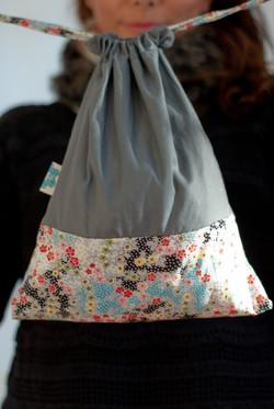 Draw string bag bi-fabrics