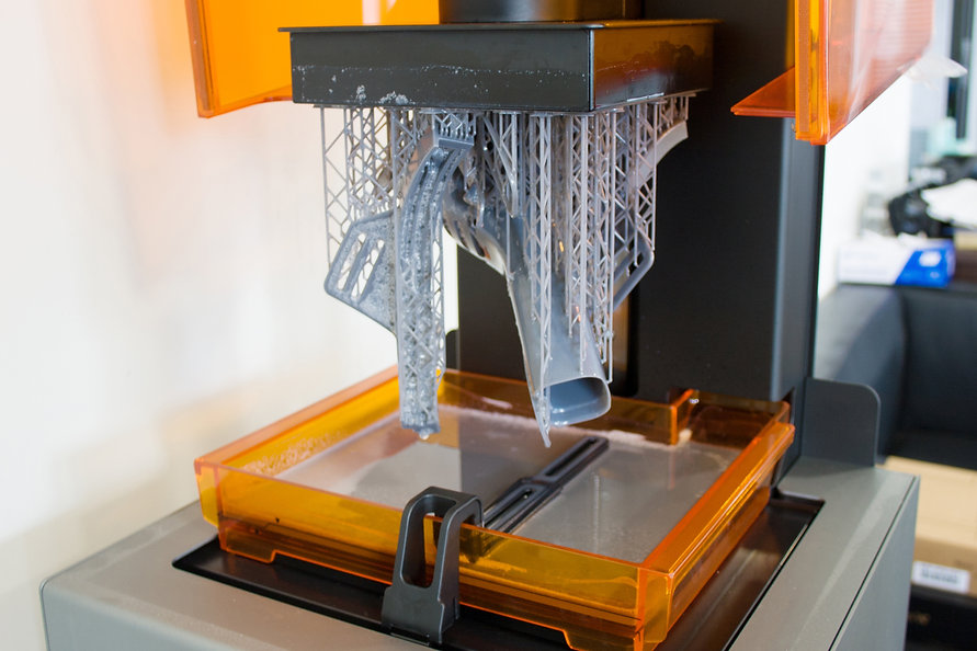3D printing process. Automation technology 3D printing a modern swimming mask.jpg