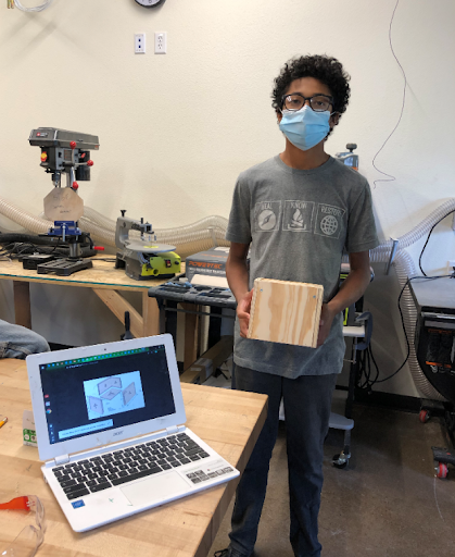 This student's CARE project involved learning how to use woodshop tools to make a box. He came to the school building to work with the shop tools and receive instruction from staff.