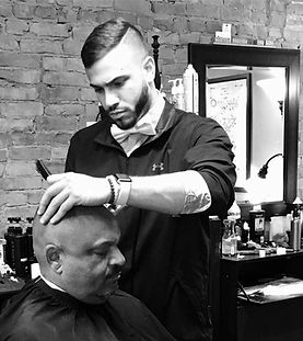 Dominic Vazquez who also goes by Dom has had a passion for barbering his whole life. For Dom it started at a early age, going to barbershops and being immersed in the culture. It was at the age of 13 when he picked up clippers and started mastering his skills. Dom continued throughout high school and college cutting his friends hair and realizing it was his passion. So in 2015 Dom decided to go to barber school at Shear Ego and has since been a full time barber. Favorite Haircut - Faded Mohawk