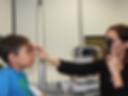 eye doctor checking child