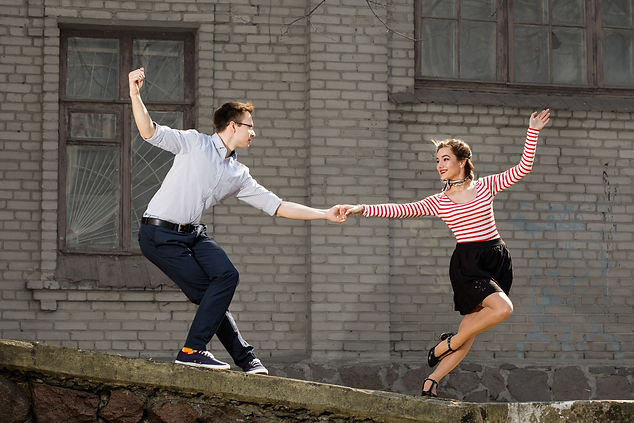 young couple dancing swing outside in fr