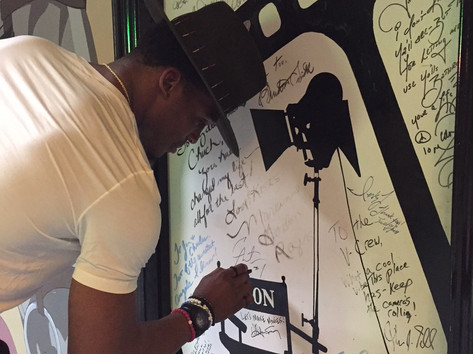 Cam Newton signing the wall