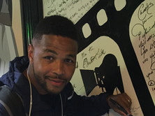 Inky Johnson signing the wall