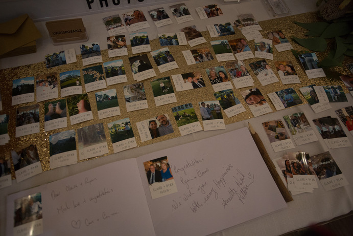 polaroids on table and in album