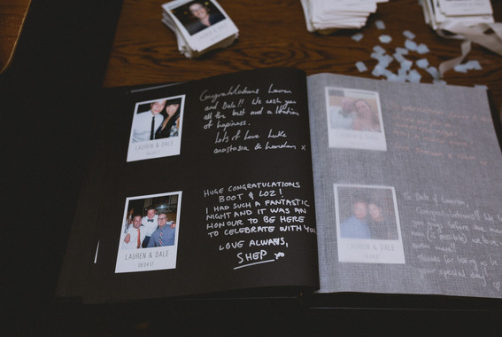 polaroids and messages in signing album