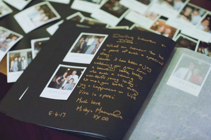 album with polaroids and messages