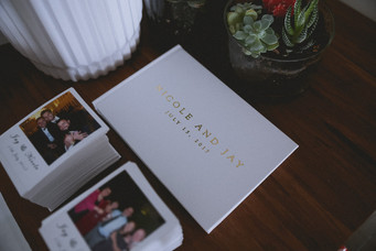 white custom guest album with stacks of polaroids