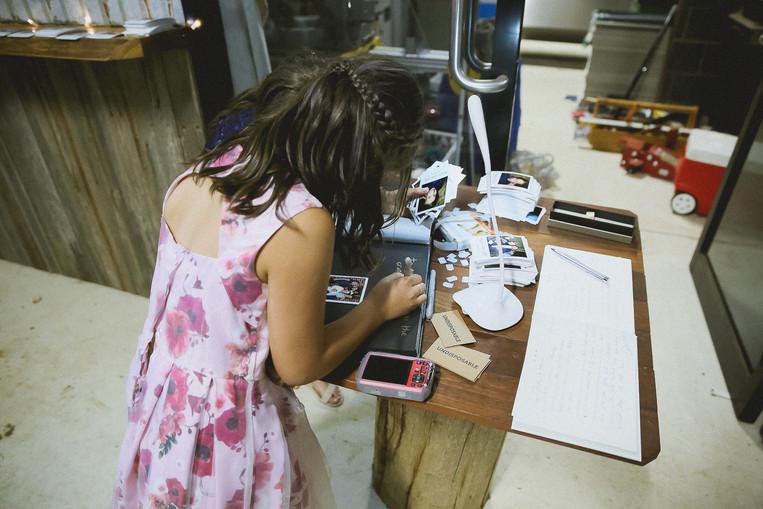 kids signing wedding album