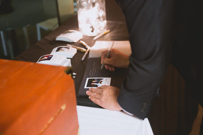 guests filling out album