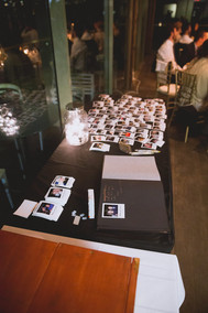 polaroids on table with album