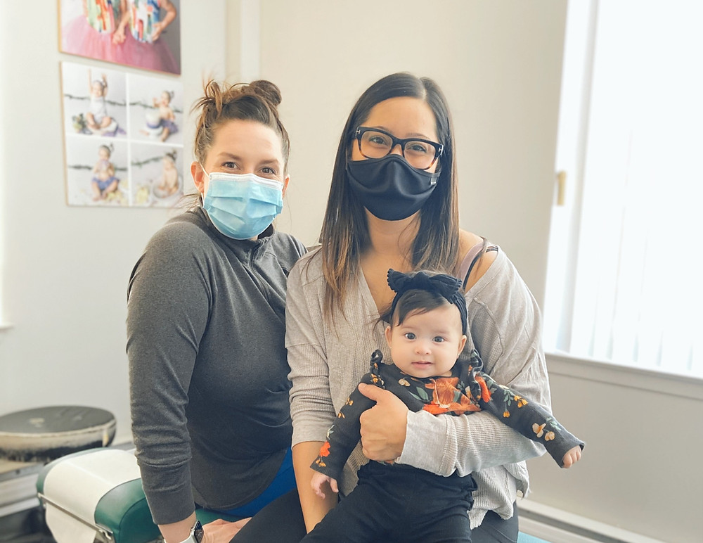 Sarah and her daughter pose for a family photo with Dr. Tara Sutton following an adjustment.