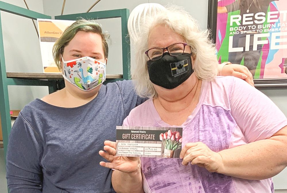 Rita and Tamika with $100 Advanced Vitality Gift Certificate