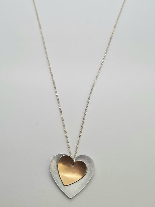 Recycled biscuit tin and copper heart necklace