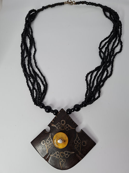 Beaded necklace with wooden pendant
