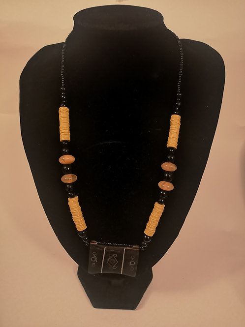 Beaded necklace with vinyl disks and wooden pendant