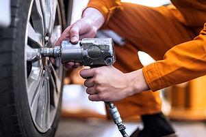 Mechanic performing car maintenance