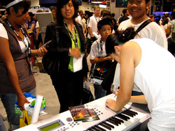 Signing flyers at ComicCon